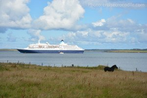 Cruise ship drops anchor to tender passengers ashore to the cruise tender pier in Kirkwall